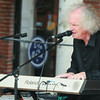 """BRYAN EATON/ Staff Photo. Newburyport resident Andy Pratt, who gained fame with his '70's hit """"Avenging Annie"""" belts out some tunes on the Inn Street Stage yesterday."""