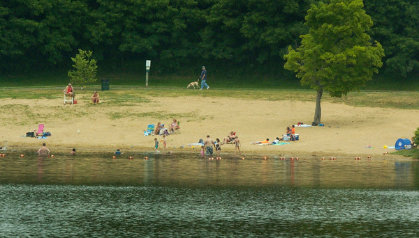 BRYAN EATON/ Staff Photo. Lake Gardner Beach was one of several places to cool off yesterday to deal with the muggy weather, though there was a pleasant breeze at the beaches. After rain forecast today, the weather should be seasonable and drier for the weekend.