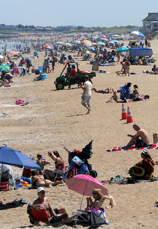 JIM VAIKNORAS/Staff photo People crowd Salisbury Beach on a hot July Day.