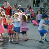 JIM VAIKNORAS/Staff photo PKids dance to the music of Marcus Gail  at Kids Day at the Millyard Saturday night in Amesbury. The event was to be held Wednesday , but was moved to saturday night due to the weather.