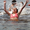 BRYAN EATON/ Staff Photo. Hannah Thompson, 12, jumps out of the water at Lake Gardner Beach in Amesbury yesterday afternoon. She was with a group of youngsters in the Newburyport Youth Services Summer Program cooling off and had earlier been sailing on Merrimack in the Lawrence Community Boating Program.