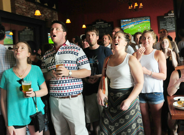 BRYAN EATON/ Staff Photo. Patrons at the Port Tavern in Newburypor react to a missed shot by the US Soccer team on the Belgian net