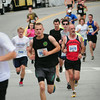 BRYAN EATON/Staff Photo. Runners in the 3-mile race run down Merrimac Street at the bottom of Green Street.