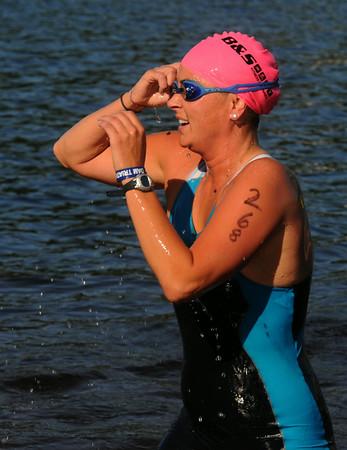 JIM VAIKNORAS/Staff photo #268 emerges from Lake Gardner in Amesbury in the 2014 Dam Triathlon Saturday.