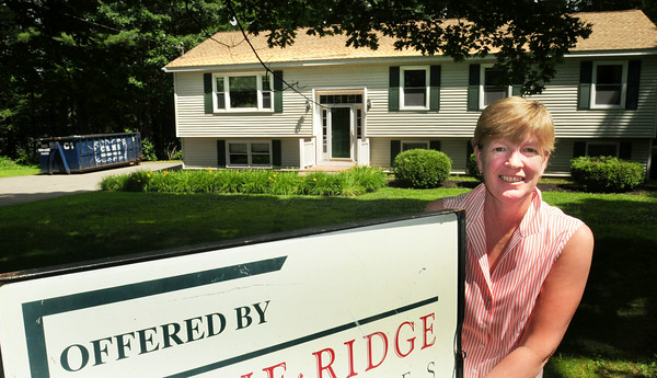 BRYAN EATON/ Staff Photo. Sally Gallagher of Stone Ridge Properties with a home listed on Woodman Road in Amesbury. Amesbury has had an upswing in the real estate market and Gallagher it's been good year for sales.
