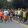 JIM VAIKNORAS/Staff photo Runners in the Lions Club Yankee Homecoming 10 mile take off on High Street in Newburyport.