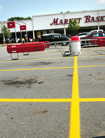 BRYAN EATON/ Staff Photo. The carriage corral is empty and there's plenty of parking at the Newburyport Market Basket yesterday afternoon.