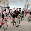 BRYAN EATON/ Staff Photo. The first leg of the Salisbury Beach Relay begins yesterday in the center. Also included with the bicycle portion was a road race and paddleboard race in areas throughout the beach.