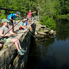BRYAN EATON/ Staff Photo. Children try their luck fishing off the bridge on Plummer Spring Road at the Artichoke Reservoir on Tuesday morning. They were with Newburyport Youth Services catching a lot of fish, though only sunfish which they released.