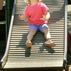 BRYAN EATON/Staff Photo. Lavinia Schoeter screams as she goes down the roller slide at the Kelley School playground on Monday. The four year-old was in the Newburyport Youth Services' Little Aces program which took to the playground after making crafts.