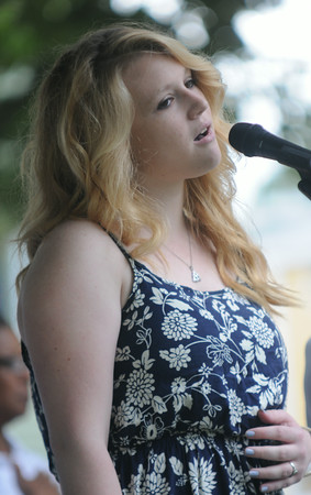 JIM VAIKNORAS/Staff photo Erin Volpone the daughter of Yankee Homecoming Chiarman Michael Volpone sings the National Anthem at Old Fashioned Sunday on the Mall in Newburyport Sunday.