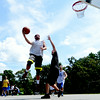 JIM VAIKNORAS/Staff photo Curran O'Connor drives to the hoop on Matt Talbot  in the The CarriageTown ThrowDown Saturday at Amesbury Park. Proceeds from the 3 on 3 basketball tournament went to the  Amesbury Educational Foundation.