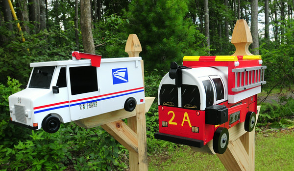 BRYAN EATON/ Staff Photo. Neighbors at a new duplex on Ferry Road in Salisbury ordered these mailboxes online. Mike Hickey is a postal clerk in the Seabrook office and he and his wife Lisa's neighbor, Wendy Kimball is a Newburyport firefighter.