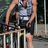 JIM VAIKNORAS/Staff photo #153 make the transition to cycling at the  2014 Dam Triathlon in Amesbury Saturday.