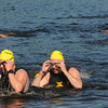 JIM VAIKNORAS/Staff photo Swimmer emerge from Lake Gardner in Amesbury in the 2014 Dam Triathlon Saturday.