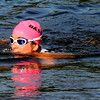 JIM VAIKNORAS/Staff photo #68 emerges from Lake Gardner in Amesbury in the 2014 Dam Triathlon Saturday.