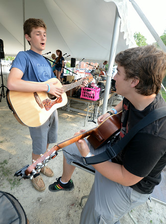 JIM VAIKNORAS/Staff photo Conner Faucher and Sam Galunis of the band High Water Horizon warm up before the Battle of the Bands on the waterfront in Newburyport last night.