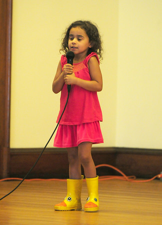 """BRYAN EATON/Staff Photo. Camila Fuentes, 4, of Newburyport sings """"Call Me Maybe"""" at the Yankee Homecoming Kids Talent Showcase which was held at the Masonic Lodge due to rain earlier in the day."""