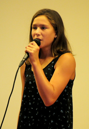 """BRYAN EATON/Staff Photo. Paige Gouldethorpe, 13, of Salisbury sing's """"I Won't Give Up"""" in the Yankee Homecoming Kids Talent Showcase."""