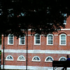 JIM VAIKNORAS?staff photo A man reads on a bench in the shade at the Bartlet Mall in Newburyport Saturday afternoon.