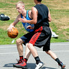 JIM VAIKNORAS/Staff photo Jack Fortin makes a move on Craig Bowen in the The CarriageTown ThrowDown Saturday at Amesbury Park. Proceeds from the 3 on 3 basketball tournament went to the  Amesbury Educational Foundation.