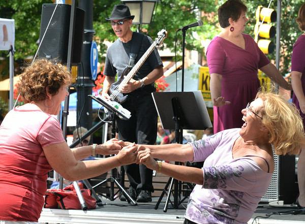 """BRYAN EATON/ Staff Photo. Stephanie Hanna, left, of West Newbury and Linda Collins of Plum Island swing to """"Chantilly Lace"""" by the group BackTrack Band in Market Square."""