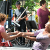 "BRYAN EATON/ Staff Photo. Stephanie Hanna, left, of West Newbury and Linda Collins of Plum Island swing to ""Chantilly Lace"" by the group BackTrack Band in Market Square."