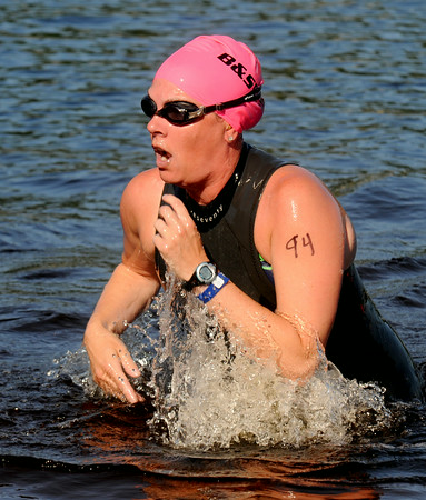 JIM VAIKNORAS/Staff photo #94 emerges from Lake Gardner in Amesbury in the 2014 Dam Triathlon Saturday.