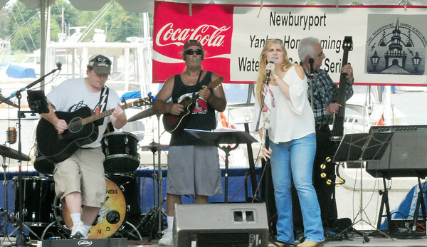 BRYAN EATON/ Staff Photo. The Anthony Edwinds Band plays on the Waterfront Stage hoping the rain wouldn't start again to disperse their audience, which it didn't.
