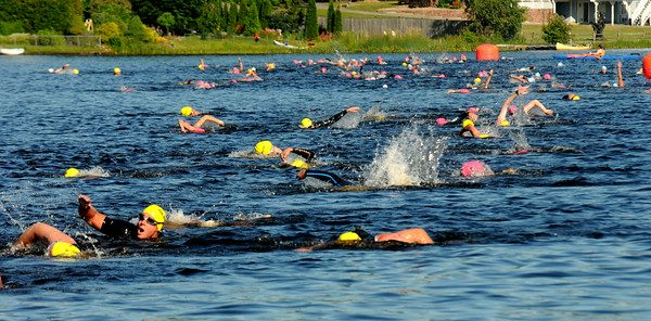 JIM VAIKNORAS/Staff photo Swimmer in Lake Gardner in Amesbury at  the 2014 Dam Triathlon Saturday.