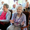 """BRYAN EATON/ Staff Photo. Residents of Brigham Manor clap and sing to """"You Are My Sunshine"""" by the Dick Kaplan Excellent Jazz Band in their Nursing Home Series."""