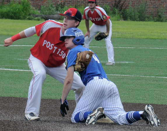 JIM VAIKNORAS/Staff photo Newburyport's Justin Cashman tags out Haverhill's Kevin Regan on a steak attempt at second during their game at Haverhill Stadium Saturday.