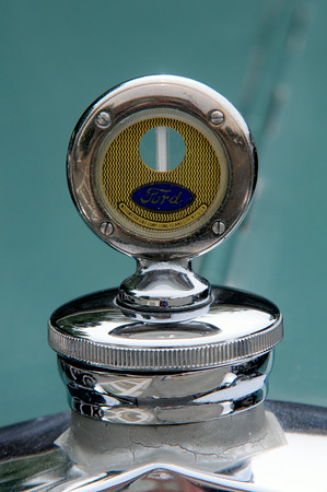 JIM VAIKNORAS/Staff photo The hood ornament on a 1938 Ford, one of the many cars at the Amesbury antique car show on Chestnut Street in Amesbury Saturday.