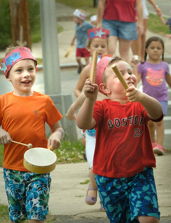 """BRYAN EATON/ Staff Photo. Youngsters from the Newburyport YWCA Childcare Center had a Fourth of July Parade around the Bartlet Mall yesterday morning. They made little patriotic costumes and had instruments to sing """"Yankee Doodle Dandy"""" and """"You're a Grand Ole Flag."""""""
