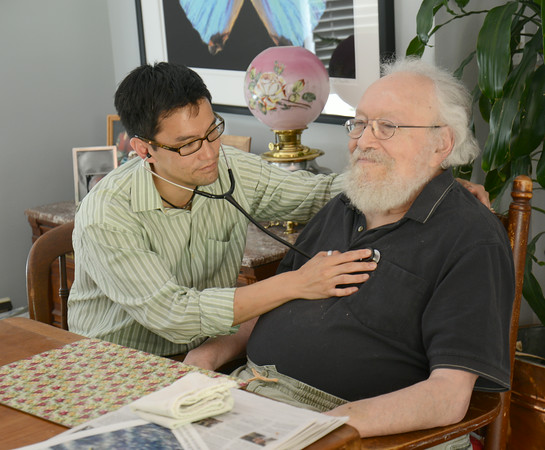 JIM VAIKNORAS/Staff photo Dr. Mark Su makes a house call with Harold Feinstein at his Merrimac home.