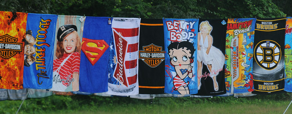 JIM VAIKNORAS/Staff photo A variety of colorfull beach towels for sail on the corner of Rt1 and rt 286 in Seabrook.