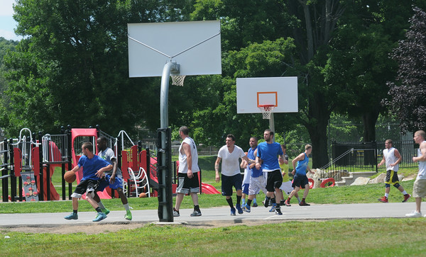 JIM VAIKNORAS/Staff photo  Both courts at Amesbury Park were full Saturday with the TheCarriageTownThrowDown Saturday at Amesbury Park. Proceeds from the 3 on 3 basketball tournament went to the