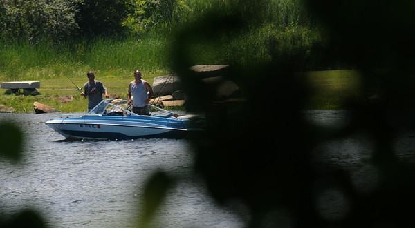 JIM VAIKNORAS/Staff photo Two fishermen work the wter off Deer Island in Amesbury Saturday morniong.