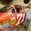 JIM VAIKNORAS/Staff photo Eddie MacDonald with the #71 car at Grimm Racing in Newburyport.