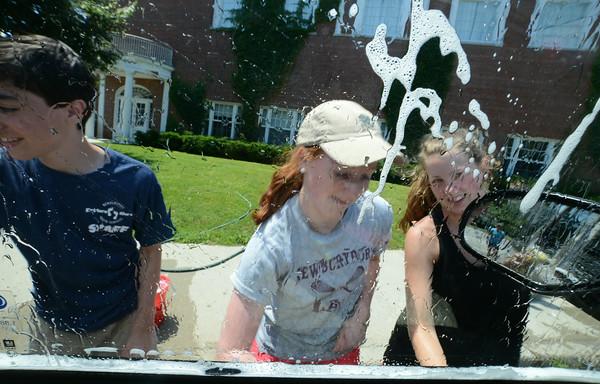 JIM VAIKNORAS/Staff photo  Nick Bushnell, Samantha Orlando, and Hannah Rikeman wash cars Saturday at Newburyport high school to raise money for the NHS Class of 2016.
