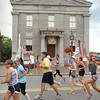 BRYAN EATON/Staff Photo. Runners of the Yankee Homecoming Roadrace go past the Custom House Maritime Museun, one of many landmarks along the courses.
