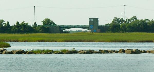 BRYAN EATON/ Staff Photo. View of Wilkinson Bridge on the Plum Island Turnpike under which the Plum Island River flows.