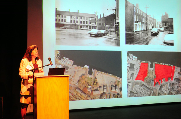 BRYAN EATON/ Staff Photo. Under photos of downtown Newburyport before redevelopment and aerials of the waterfront Mayor Donna Holaday speaks at a mayor's conference at the Firehouse Center yesterday morning.