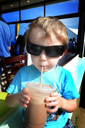 JIM VAIKNORAS/Staff photo <br /> Jaxson Iannuccillo , 3, of Amesbury enjoys a refreshing chocolate milk at the Groundswell Coffee Grand Opening on Salsibury Beach Thursday night.