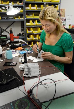 BRYAN EATON/Staff Photo. Amanda Thach assembles leaf chambers.