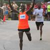 JIM VAIKNORAS/Staff photo <br /> Glarias Rop edges out. Menoistu Nebsi to win the Yankee Homecoming 10 mile race Tueday night