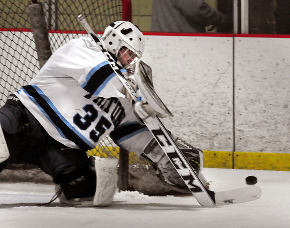 Newburyport: Triton goalie Spencer Norton deflects the puck by a Lynnfield player. Bryan Eaton/Staff Photo