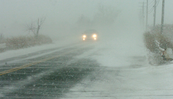 Newbury: Spots along the Plum Island Turnpike were in white out conditions as winds from the north blew the fluffy snow across the roadway. Bryan Eaton/Staff Photo