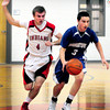 Amesbury: Georgetown's Ryan Slack moves down the court with Amesbury's Patrick Halloren moving in. Bryan Eaton/Staff Photo