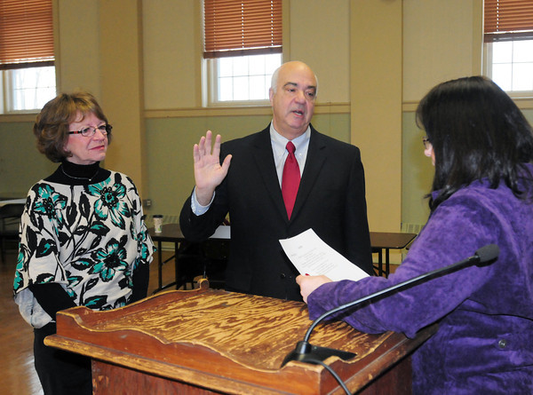Amesbury: Amesbury city clerk Bonnijo Kitchin, right, swears in new mayor Ken Gray with his wife, Donna, by his side. Bryan Eaton/Staff Photo